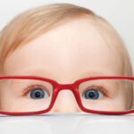Infant Vision - Child looking though the opposite side of glasses