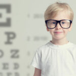 Vision Problems - Young Boy wearing glasses to big for his face