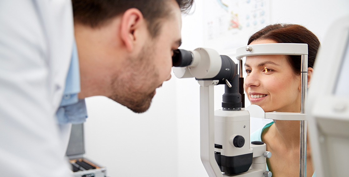 An Eye Doctor performing a slit lamp exam on a patient