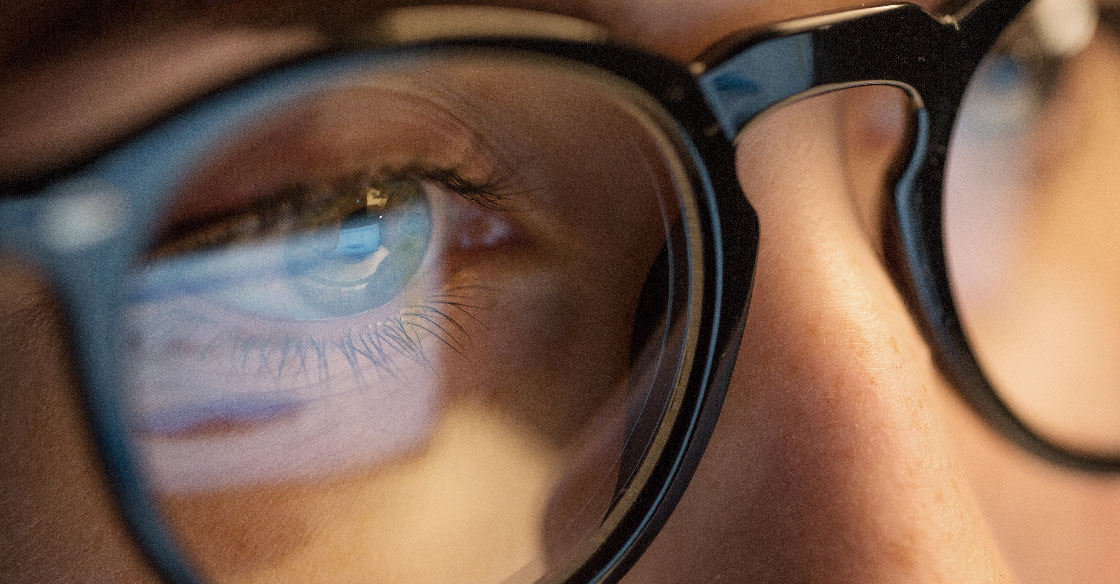 Closeup of an eye and glasses