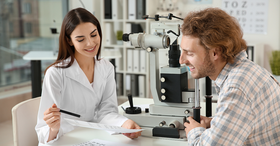 Optometrist reviewing chart with patients