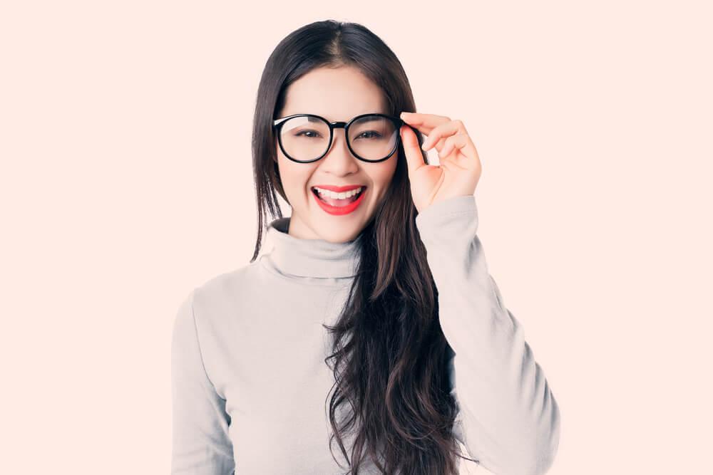 Happy woman wearing glasses.